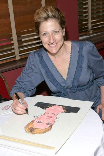 Edie Falco Signs Her Caricature at Sardi's In New York City