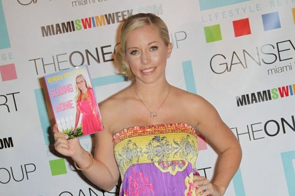 Kendra Wilkinson greets fans and signs her book 'Sliding Into Home' at the One Group Lifestyle Retreat at Gansevoort South on July 17, 2010 in Miami Beach, Florida