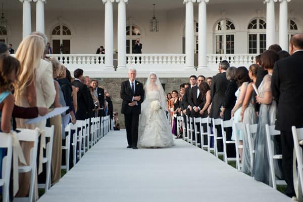 former U.S. President Bill Clinton (L) walks Chelsea Clinton down the aisle during her wedding to Marc Mezvinsky at the Astor Courts Estate on July 31, 2010 in Rhinebeck, New York.