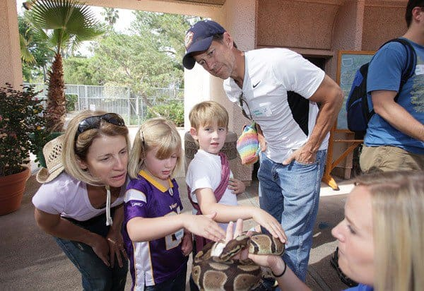James Denton, his daughter Malin (5), son Sheppard (7) and wife Erin watch as a zoo worker displays a python snake at the San Diego Zoo on July 31, 2010 in San Diego, California. He and his family attended an Overnight Visit at the zoo.