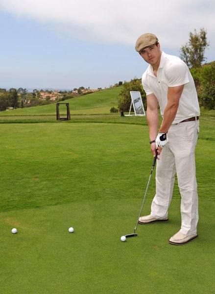 Kellan Lutz golfs at Pelican Hill Resort on July 31, 2010 in Newport Beach, California.