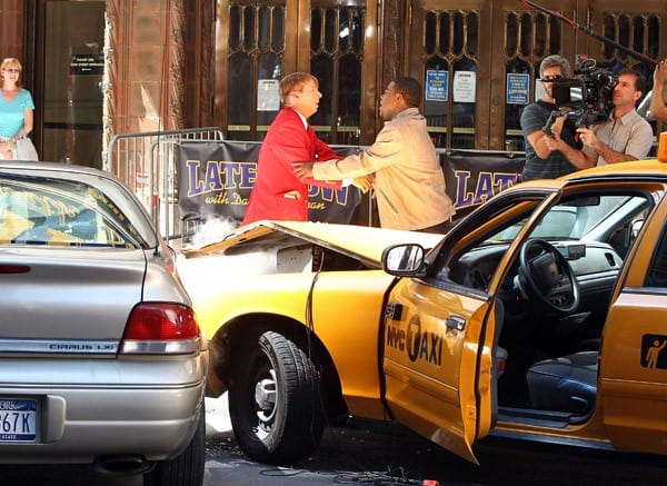 Actors Jack McBrayer and Tracy Morgan on location for '30 Rock' on the streets of Manhattan on August 27, 2010 in New York City.
