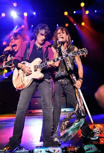 Joe Perry and Steven Tyler of Aerosmith perform at Nikon at Jones Beach Theater on August 12, 2010 in Wantagh, New York.