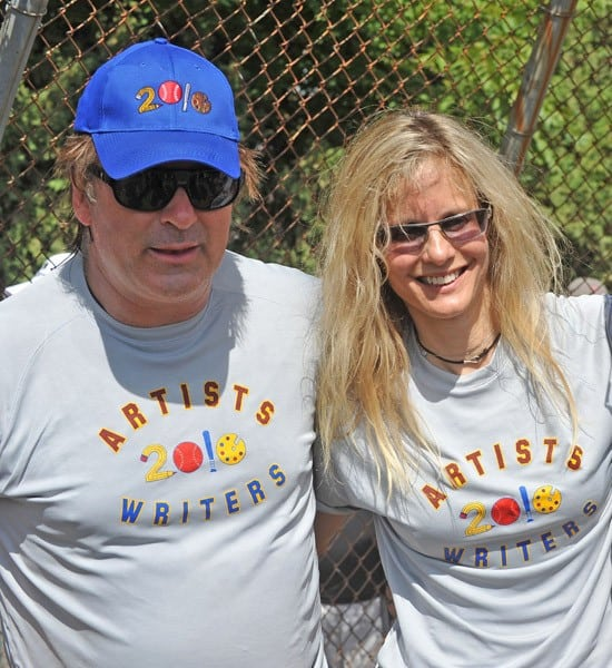 Alec Baldwin and Lori Singer attend the 62nd Annual Artist and Writers Charity Softball Game at Herrick Park on August 14, 2010 in East Hampton, New York.
