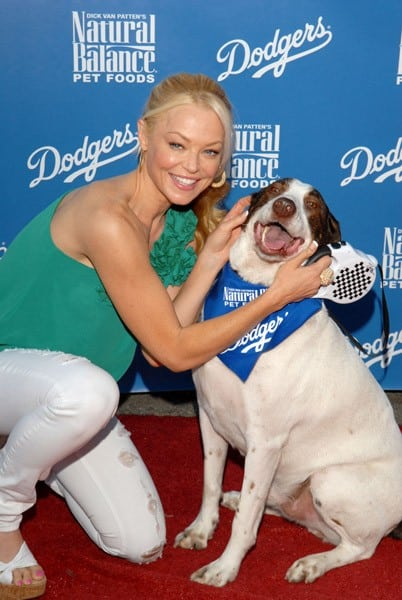 Actress Charlotte Ross and her dog Tyler attend Bark in the Park event prior to the Los Angeles Dodger game on August 21, 2010 in Los Angeles, California.