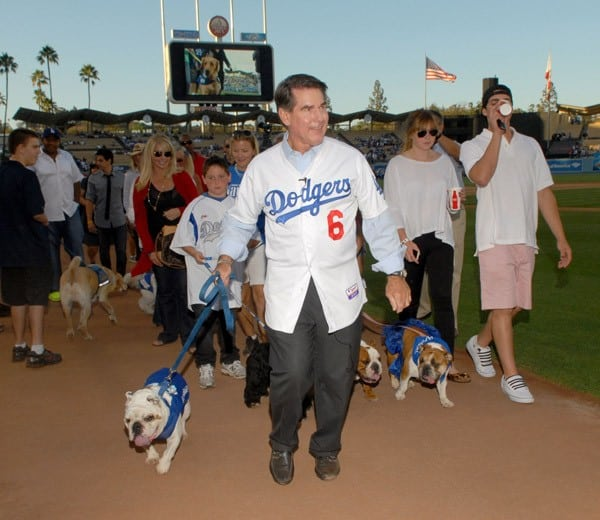 Former MLB player Steve Garvey (C) leads the parade at Bark in the Park event prior to the Los Angeles Dodger game on August 21, 2010 in Los Angeles, California.