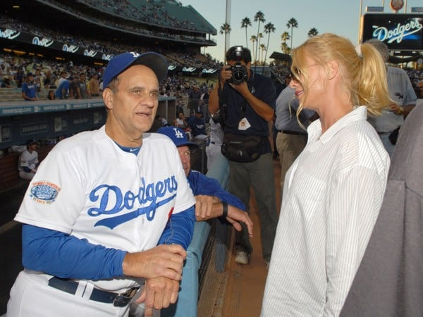 Los Angeles Dodger manager Joe Torre (L) talks with actress Nicollette Sheridan after she threw out the ceremonial first pitch prior to the Los Angeles Dodger game on August 21, 2010 in Los Angeles, California.