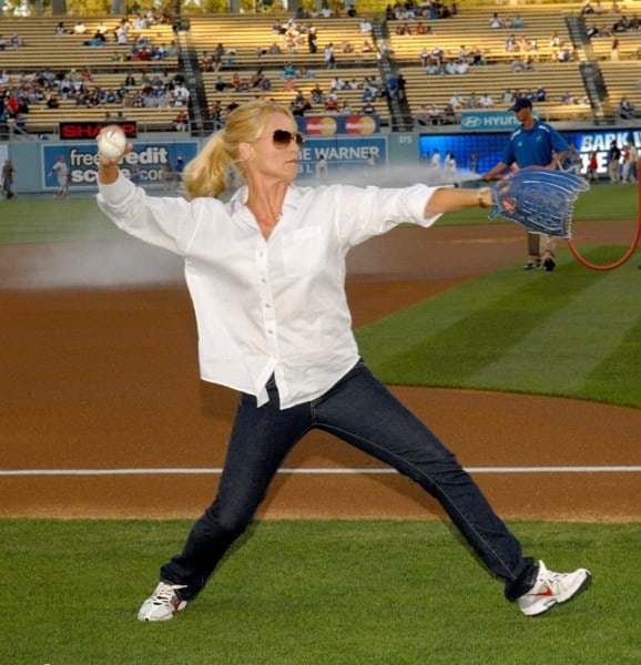 Actress Nicollette Sheridan warms up before throwing out the ceremonial first pitch prior to the Los Angeles Dodger game on August 21, 2010 in Los Angeles, California.