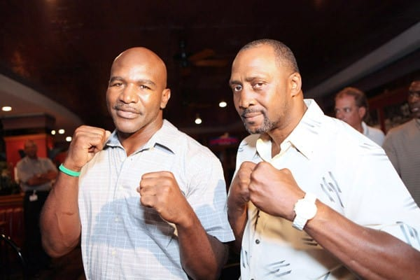 Champion boxers Evander Holyfield and Thomas Hearns strike a pose at the press conference to announce a new partnership between Evander Holyfield and Forgotten Harvest at Joe Louis Arena on August 12, 2010 in Detroit, Michigan.