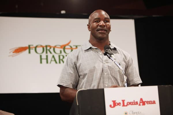 Five-time heavyweight champion Evander Holyfield speaks at the press conference to announce a new partnership between Evander Holyfield and Forgotten Harvest at Joe Louis Arena on August 12, 2010 in Detroit, Michigan.