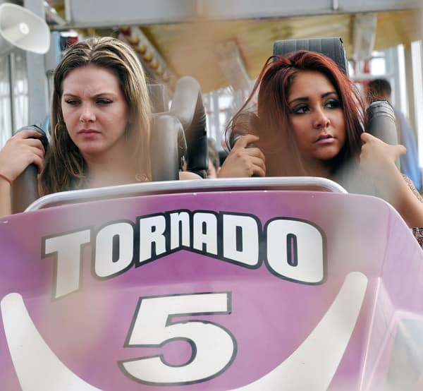 "Nicole ""Snooki"" Polizzi and her friend Ryder filming on location for ""Jersey Shore"" at Seaside Heights on August 8, 2010 in Seaside Heights, New Jersey."
