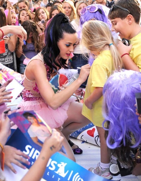 Katy Perry signs autographs for fans on NBC's 'Today' in Rockefeller Center on August 27, 2010 in New York City.