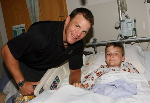 Shawn Thornton (C) visits patients at Children's Hospital Boston on August 19, 2010 in Boston, Massachusetts.