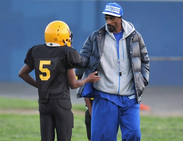 Snoop Dogg kicked-off his youth football team's practice by announcing his latest collaborative project - his own coffee cup for 7-Eleven's 'Coffee Cup With A Cause' program on September 7, 2010 in Pomona, California.