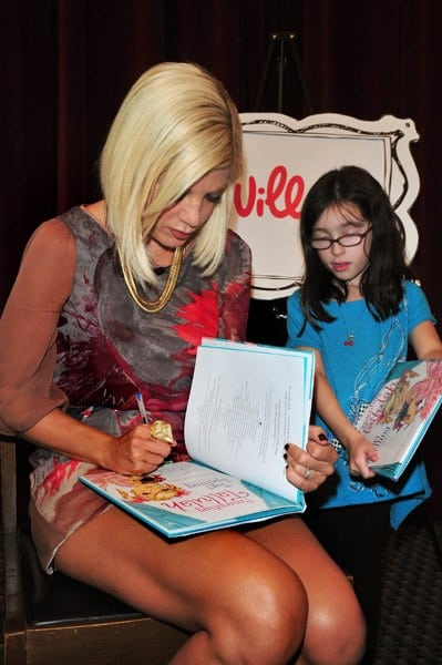 Tori Spelling promotes 'Presenting... Tallulah' during the iVillage Read Along With event at the New York Public Library Jefferson Market Branch on September 22, 2010 in New York City.