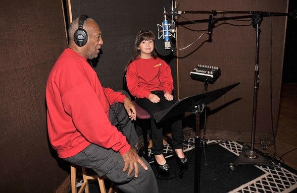 Bill Cosby brings the giggle out of eight year old Jackie Chavez, winner of the JELL-O 'Give it a Giggle' audition at Avatar Studios on October 19, 2010 in New York City.