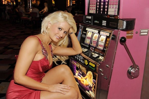 Holly Madison poses for photos with New Planet Holly slot machines at Planet Hollywood Casino Resort on October 5, 2010 in Las Vegas, Nevada.
