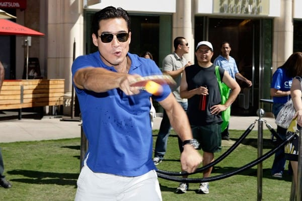 Mario Lopez plays ping pong at his birthday party at The Americana at Brand on October 9, 2010 in Glendale, California.