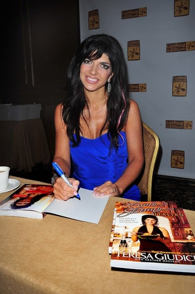TV personality Teresa Giudice signs copies of her cook book 'Skinny Italian' during the Feed the Hungry charity event at The American Hotel on October 10, 2010 in Freehold, New Jersey.