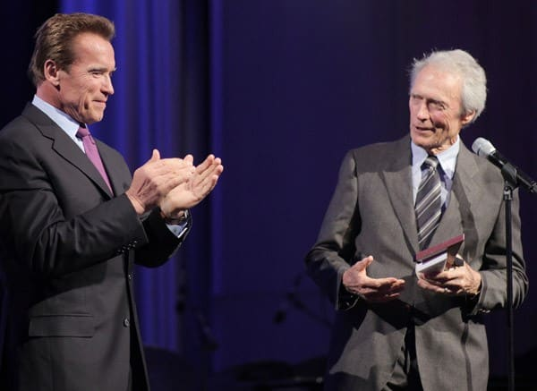 California Governor Arnold Schwarzenegger presents the Tolerance Award to Clint Eastwood at the International Film Festival partnering with Grey Goose at the Museum Of Tolerance on November 14, 2010 in Los Angeles, California.