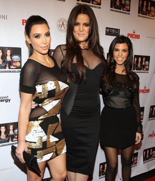 Kim Kardashian, Khloe Kardashian and Kourtney Kardashian attend the launch of the Kardashian MasterCard at Pacha on November 9, 2010 in New York City.