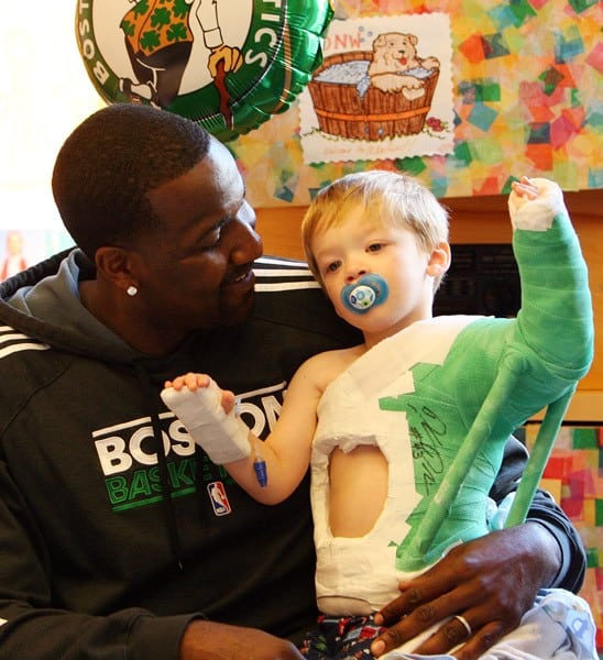 Boston Celtics' Kendrick Perkins visits a patient at Children's Hospital Boston on November 18, 2010 in Boston, Massachusetts.