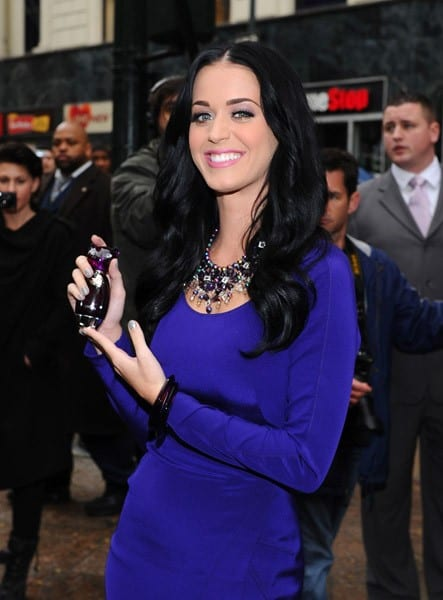 Katy Perry poses at the Launch of Purr by Katy Perry for Nordstrom Pop-Up NYC Event at Greeley Square Park on November 16, 2010 in New York City.