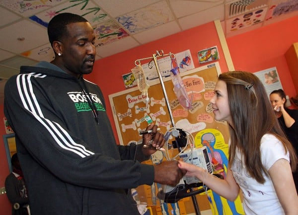 Boston Celtics' Kendrick Perkins visits patients at Children's Hospital Boston on November 18, 2010 in Boston, Massachusetts.