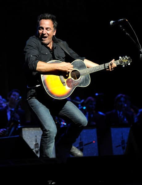 Bruce Springsteen performs on stage during the 'Stand Up for Heroes' at the Beacon Theatre on November 3, 2010 in New York City.