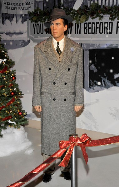 Karolyn Grimes, aka 'ZuZu Bailey,' stands next to the Jimmy Stewart figure, at the unveiling of the 'It's A Wonderful Life' Wax Exhibit at Madame Tussauds Hollywood on November 29, 2010 in Hollywood, California.