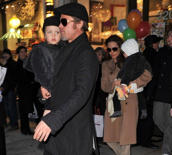 Brad Pitt and Angelina Jolie visit Lee's Art Shop with their children Vivienne Jolie-Pitt and Knox Jolie-Pitt on December 4, 2010 in New York City.