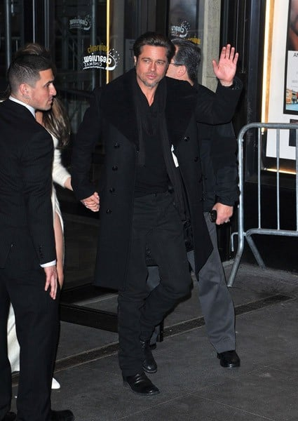 Angelina Jolie and Brad Pitt leave the world premiere of 'The Tourist' at the Ziegfeld Theatre on December 6, 2010 in New York City.