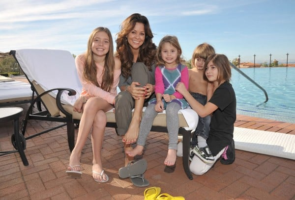 Brooke Burke and her children pose for a photo poolside during their holiday getaway at Pelican Hill Resort on December 28, 2010 in Newport Beach, California.