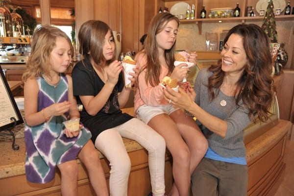 Brooke Burke and her children enjoy gelato during their holiday getaway at Pelican Hill Resort on December 28, 2010 in Newport Beach, California.