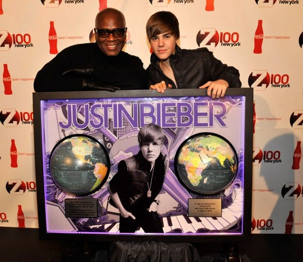 Island Def Jam Chairman LA Reid presents Justin Bieber with multi-platinum plaque for sales of over 9 million worldwide at Hammerstein Ballroom on December 10, 2010 in New York, New York.