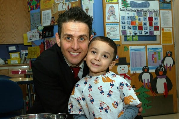 Joey McIntyre visits a patient at Children's Hospital Boston on December 20, 2010 in Boston, Massachusetts.