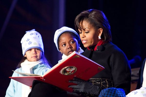 Michelle Obama reads to children at the 2010 National Christmas Tree Lighting presented by the National Park Service and the National Park Foundation at President's Park on December 9, 2010 in Washington, DC.