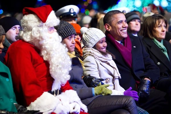 U.S. President Barack Obama and his daughters Sasha and Malia sit alongside Santa Claus at the 2010 National Christmas Tree Lighting Ceremony presented by the National Park Service and the National Park Foundation at President's Park on December 9, 2010 in Washington, DC.
