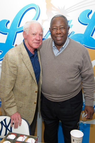Whitey Ford and Hank Aaron greet fans at Last Licks on December 11, 2010 in New York City.