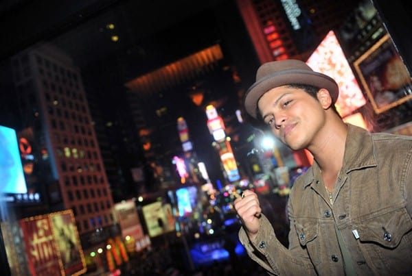 Singer Bruno Mars poses for pictures in front of Times Square during the R Lounge New Year's Eve 2011 at the Renaissance New York Times Square Hotel on December 31, 2010 in New York City, New York.