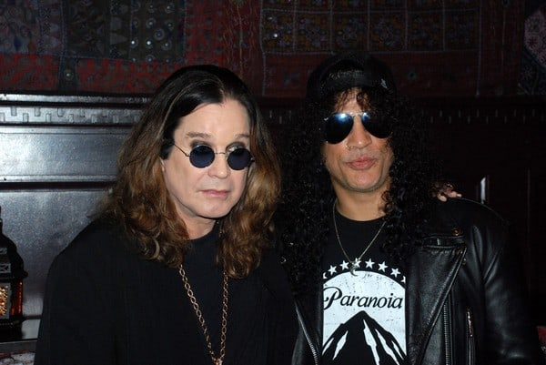 Ozzy Osbourne and Slash Sign 10 Foot Guitar at House of Blues in Hollywood on January 10, 2011