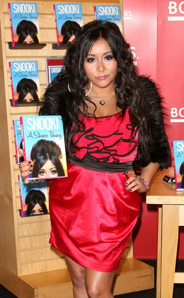 Nicole 'Snooki' Polizzi signs copies of 'A Shore Thing' at Borders Columbus Circle on January 10, 2011 in New York City.