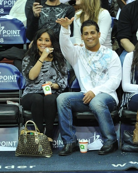 Nicole 'Snooki' Polizzi and Kim Kardashian attend the Dallas Mavericks vs New Jersey Nets game at the Prudential Center on January 22, 2011 in Newark, New Jersey.