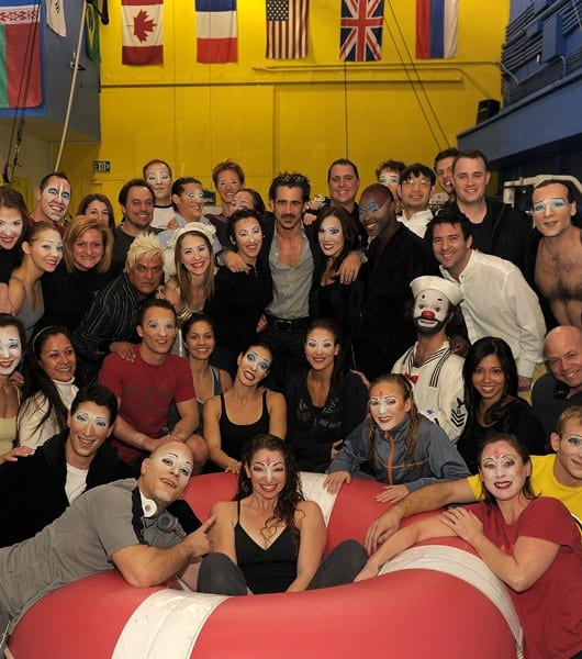 Colin Farrell poses for photos with the cast backstage at 'O' by Cirque du Soleil at Bellagio Las Vegas on February 3, 2011 in Las Vegas, Nevada.