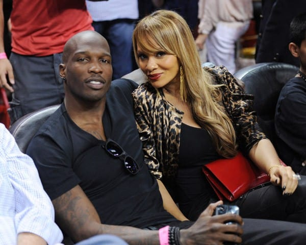 Chad Ochocinco and his his fiancé Evelyn Lozado attend The Miami Heat vs New York Knicks Games at American Airlines Arena on February 27, 2011 in Miami, Florida.