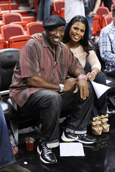 Michael Clarke Duncan and Omarosa Stallworth attend The Miami Heat vs New York Knicks Games at American Airlines Arena on February 27, 2011 in Miami, Florida.
