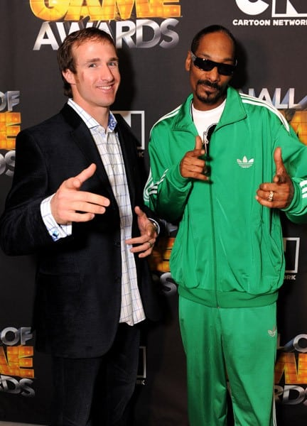 New Orleans Saints quarterback Drew Brees and Rapper Snoop Dogg attend the Cartoon Network Hall of Game Awards held at The Barker Hanger on February 21, 2011 in Santa Monica, California.