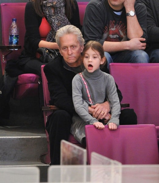 Michael Douglas and daughter Carys Zeta Douglas attend the Pittsburgh Penguins vs New York Rangers game at Madison Square Garden on February 13, 2011 in New York City.