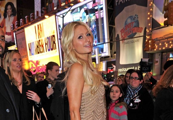 Paris Hilton poses for photographers in Times Square after leaving MTV's 'The Seven' on February 17, 2011 in New York City.