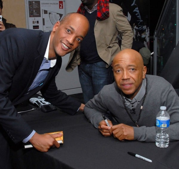 Russell Simmons greets a fan after Icons of the Music Industry: Russell Simmons at The GRAMMY Museum on February 25, 2011 in Los Angeles, California.